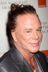 Mickey Rourke sporting his obvious Pixie-ear and man-bun on the red carpet